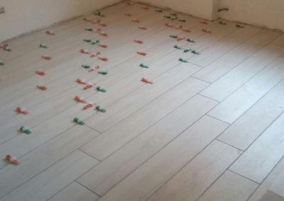 sistema di posa per piastrelle e pavimenti